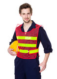 Builder with waistcoat and hold a helmet Stock Photo