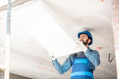 Workman warming the building royalty free stock images
