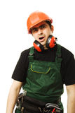 The builder was tired. Tired man in a construction helmet on a white background Stock Images