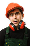 The builder was tired. Tired man in a construction helmet on a white background Royalty Free Stock Photo