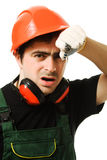 The builder was tired. Tired man in a construction helmet on a white background Stock Photos