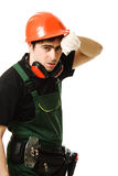 The builder was tired. Tired man in a construction helmet on a white background Stock Photo