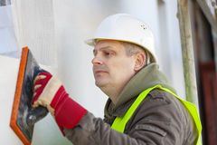 Builder with wash float Royalty Free Stock Photo