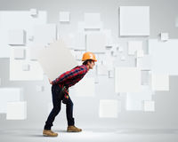 Builder among white cubes Royalty Free Stock Photos