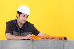 Builder With A Spirit Level Royalty Free Stock Photo