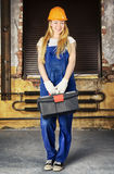 Builder Woman. Beautiful blond woman with toolbox in his hand Royalty Free Stock Photography