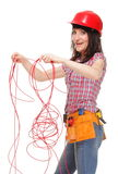 Builder woman with entangled red cable Stock Photo