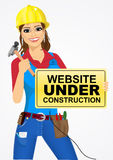 Builder woman with hammer Royalty Free Stock Image