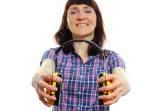 Builder woman holding protective headphones Royalty Free Stock Photography