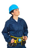 Builder woman looking up Stock Images