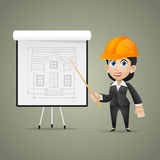 Builder woman points on flipchart Royalty Free Stock Images