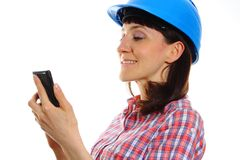 Builder woman in protective helmet using mobile phone Stock Photos
