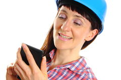 Builder woman in protective helmet using mobile phone Stock Photo