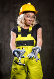 Builder woman with tools Royalty Free Stock Image