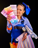 Builder woman with wallpaper Royalty Free Stock Photos