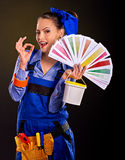Builder woman with wallpaper. Builder woman with painting can showing ok . Fashion Stock Photos