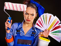 Builder woman with wallpaper. Royalty Free Stock Image