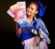 Builder woman with wallpaper. Stock Images