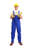 Builder with wooden ruler stock photos