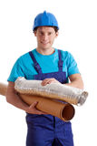 Builder during work. Builder holding a different kinds of pipes Royalty Free Stock Photo
