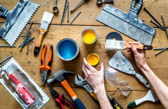 Builder work with professional repairing implements set on wooden background top view Stock Images