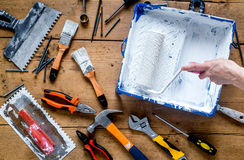 Builder work with professional repairing implements set on wooden background top view Royalty Free Stock Image