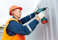 Builder worker assembling metal construction stock images