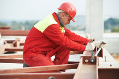 Builder worker assembling metal construction Stock Photos