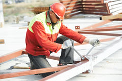 Builder worker assembling metal construction Royalty Free Stock Images