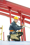 Builder worker assembling metal construction Stock Image
