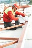 Builder worker assembling metal construction Stock Photography