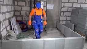 Builder worker breaks part of the wall.  stock footage