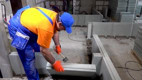 Builder worker breaks part of the wall.  stock video footage