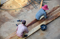Builder worker build local lao style no have in safety protectiv. E equipment in Construction Site at Pakse in Champasak, Laos Royalty Free Stock Photo