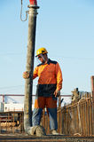Builder worker at concrete pouring work Stock Images