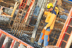 Builder worker at concrete work Stock Photography