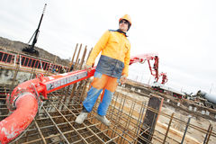 Builder worker at concrete work Stock Photo