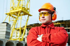 Builder worker at construction site. Builder worker in uniform and safety protective equipmant at construction site Stock Images