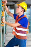 Builder or worker controlling building or construction site Royalty Free Stock Photography