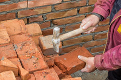 Builder worker cutting a brick 2 Stock Photos