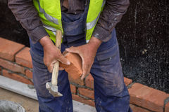 Builder worker cutting a brick 3 Royalty Free Stock Photos
