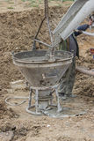Builder worker filling concrete funnel Royalty Free Stock Photo