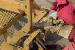 Builder worker holding connecting pin Royalty Free Stock Image