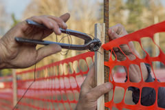 Builder worker Installing Construction Safety Fence 3 Stock Images