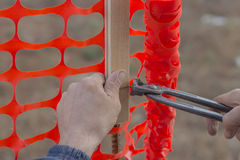 Builder worker Installing Construction Safety Fence 4 Royalty Free Stock Images