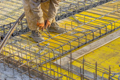 Builder worker Installing Steel Work 2. Builder worker Installing Steel Work Before Concrete Pour Stock Photos
