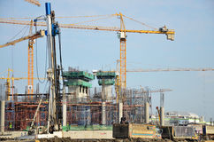 Builder worker with Machinery Building Construction Site Royalty Free Stock Photography