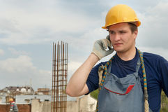 Builder worker with mobile phone Royalty Free Stock Photo