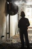 Builder worker operating demolition machine Stock Image