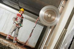 Builder worker operating demolition machine Royalty Free Stock Photo